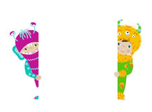 Cute kids in monster costumes with white board Royalty Free Stock Photography