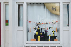 Cute kids paper crafts display at nursery house's window for celebrating on October 31, Halloween day. Stock Photos