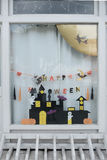 Cute kids paper crafts display at nursery house's window for celebrating on October 31, Halloween day. Stock Image