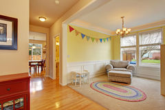 Cute kids play room with rug. Royalty Free Stock Image