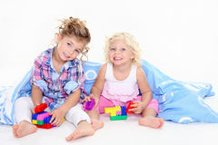Cute kids playing blocks. Little girls playing with blocks Royalty Free Stock Photos