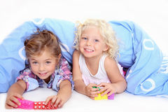 Cute kids playing blocks Stock Photos