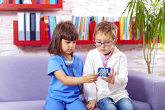 Cute kids playing doctors in office Royalty Free Stock Photo