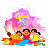 Cute kids playing Happy Holi. Stock Images