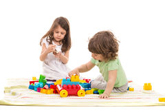 Cute kids playing home Stock Images