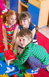 Cute kids playing at kindergarten Stock Photography