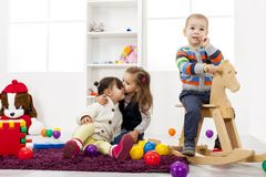 Kids playing in the room Stock Photos