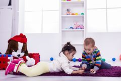 Kids playing in the room Royalty Free Stock Images