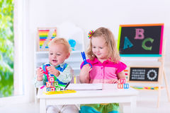 Cute kids at preschool painting Royalty Free Stock Images