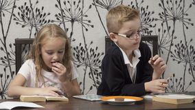 Cute kids read the books indoors stock video footage