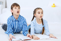 Cute kids reading books stock images