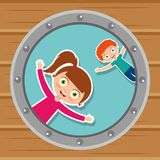 Cute kids in the round window happy Royalty Free Stock Image