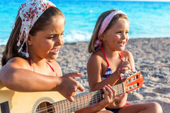 Cute kids singing together on beach Stock Images
