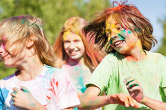 Cute kids smeared with colored powder on Holi fest Royalty Free Stock Images