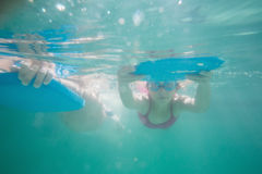Cute kids swimming underwater in pool Stock Photo