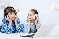 Cute kids using devices Stock Photos