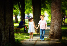 Cute kids walking together in summer park Royalty Free Stock Photo