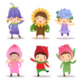 Cute kids wearing flowers costumes Stock Photos