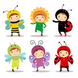 Cute kids wearing insect and flower costumes Stock Images