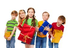 Cute kids with wrapped boxes Royalty Free Stock Photo