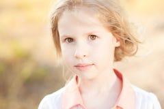 Cute kif girl outdoors. Closeup portrait of cute baby girl outdoors Stock Photo