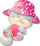 Cute kitten holding a heart Stock Image