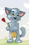 Cute kitten in love with a flower Royalty Free Stock Photos