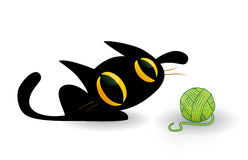Cute kitten playing with a ball of yarn. Cute black kitten with big eyes playing with a ball of yarn Royalty Free Stock Image