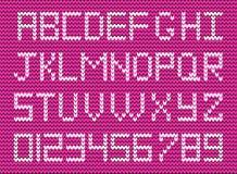 Cute knitted abc alphabet, knitting pattern on purple fabric bac Stock Photos