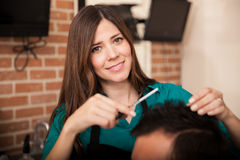 Cute lady barber at work Royalty Free Stock Photography