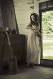 Cute lady with bare feet in the rural house Stock Photo