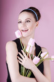 Cute lady with bouquet pink tulips. Cute young lady holds the bouquet pink tulips Stock Photo