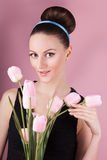 Cute lady with bouquet pink tulips Royalty Free Stock Images