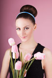 Cute lady with bouquet pink tulips Stock Images