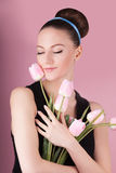 Cute lady with bouquet pink tulips Royalty Free Stock Image