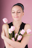 Cute lady with bouquet pink tulips Stock Photography