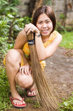 Cute Lady with Broom Stock Images