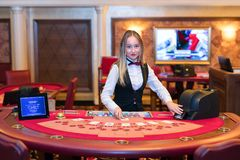 Cute lady casino dealer at Black Jack table Royalty Free Stock Images