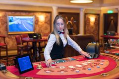 Cute lady casino dealer at Black Jack table Royalty Free Stock Image