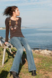 Cute lady in casual clothes on sea side Royalty Free Stock Photo