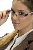 Cute lady posing with her fashionable eyewear Royalty Free Stock Image