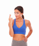 Cute lady in sport clothing crossing fingers Royalty Free Stock Photography