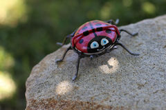 Cute ladybug stone and metal art Stock Photos