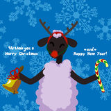 Cute lamb - symbol of the 2015 year with present. Chinese zodiac and calendar animal. Funny Christmas and New Year card Royalty Free Stock Photo