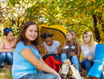 Cute large beautiful girl sitting near yellow tent Stock Photography