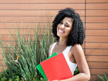 Cute latin female student woman with curly black hair Royalty Free Stock Photo