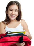 Cute latin girl carrying her school backpack Royalty Free Stock Image