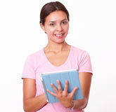 Cute latin girl using her tablet pc Stock Image