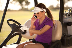 Cute Latin golfer on the phone Royalty Free Stock Photos