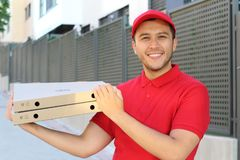Cute Latin pizza delivery guy stock image